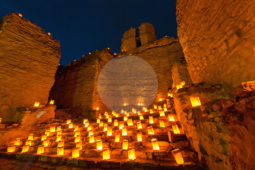 The ruins of the San José de los Jémez Mission part of the Jemez Historic Site illuminated by hundreds of small paper lanterns known as luminaria to celebrate the holiday season December 12, 2015 in Jemez Springs, New Mexico. The site is in the Jémez Indian pueblo and contains an early 17th-century mission complex.