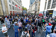 "Protestors Sscuffle with Police nearby Canada House in Central London, on Saturday Sept 19, 2020 - after thousands gathered in London's Trafalgar Square from across the UK to protest against coronavirus restrictions and reject mass vaccinations. The event, which began at noon, drew a broad coalition including coronavirus sceptics, 5G conspiracy theorists and so-called ""anti-vaxxers"". Speakers at the event accused the government of attempting to curtail civil liberties. (VXP Photo/ Vudi Xhymshiti)"