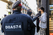 """Police appear to detain a group of youngsters who call themselves as anti-fascists after they gathered to protest against a gathering of a far-right political group """"VOX"""" in the city centre of Barcelona, on Sunday, Dec 6, 2020. (VXP Photo/ Vudi Xhymshiti)"""
