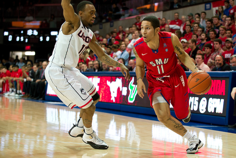 DALLAS, TX - JANUARY 4: Nic Moore #11 of the SMU Mustangs drives to the basket against the Connecticut Huskies on January 4, 2014 at Moody Coliseum in Dallas, Texas.  (Photo by Cooper Neill) *** Local Caption *** Nic Moore