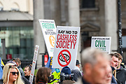 "People hold placards and banners a ""Resist and Act for Freedom"" protest against a mandatory coronavirus vaccine, wearing masks, social distancing and the second lockdown in Trafalgar Square, London on Saturday, Sept. 26, 2020. (VXP Photo/ Vudi Xhymshiti)"