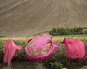 Pink cloth drying in the wind.<br /> The traditional life of the Wakhi people, in the Wakhan corridor, amongst the Pamir mountains.