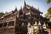 Shwenandaw Golden Palace Monastery. Built in 1880 of carved teak, Shwenandaw Monastery was originally part of the imperial palace at Amarapura