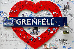 London, UK. 13 June, 2019. Tributes beneath the Grenfell Tower in North Kensington. Tomorrow, the Grenfell community will mark the second anniversary of the Grenfell Tower fire on 14th June 2017 in which 72 people died and over 70 were injured. Two years on, some family members remain in temporary accommodation and many are still traumatised. Phase 2 of the Grenfell Inquiry will begin in 2020, with criminal investigation findings expected to be sent to the Crown Prosecution Service in 2021.