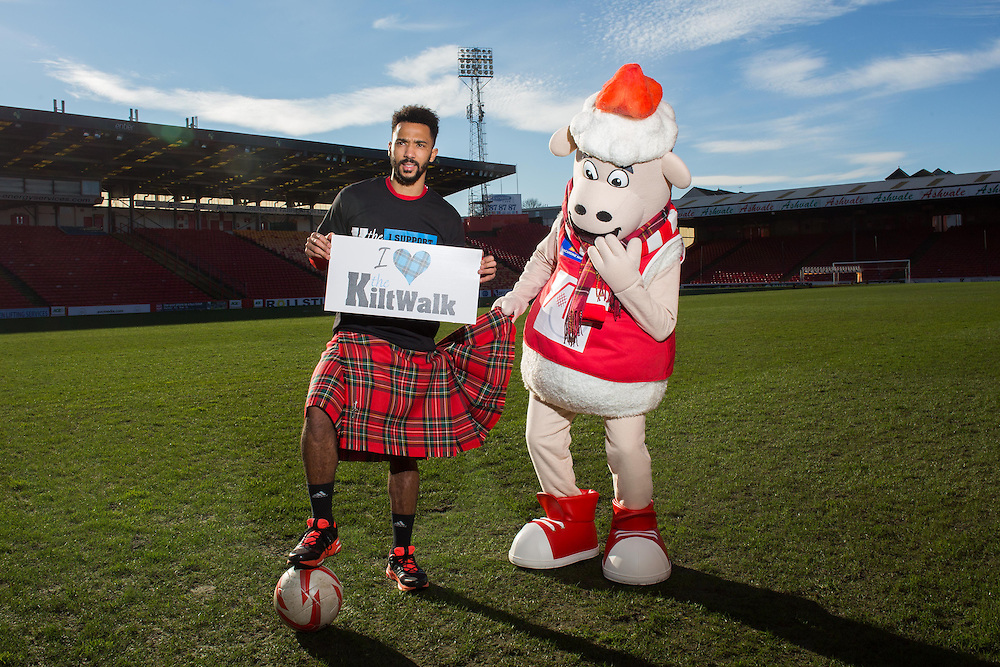 Wednesday11th February, 2015, Aberdeen, Scotland. Dons defender Shay Logan and AFC Community Trust mascot, Donny the Sheep, will officially launch the Aberdeen Kiltwalk 2015 as they call on Aberdeen fans to sign up to The Kiltwalk to raise funds for the club's partner charity, Aberdeen FC Community Trust.<br />  <br /> Pictured:  Shay Logan and Donny the Sheep<br /> <br /> (Photo: Ross Johnston/Newsline Media)