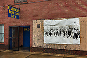 Badboys Boxing Gym with photograph of the civil rights marchers from 1965 on 3rd March 2020 in Montgomery, Alabama, United States. The Memorial for Peace and Justice is in a run-down area of central Montgomery, close by the route taken by the 1965 civil rights marchers. The route is marked and designated as a US national historic trail, with images of the marches pinned to walls, as on this building.