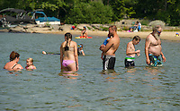 Families take a dip in the lake together at Weirs Beach on Thursday.  (Karen Bobotas/for the Laconia Daily Sun)