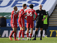 Football - 2020 / 2021 Premier League - Leicester City vs Liverpool - King Power Stadium<br /> <br /> Liverpool's Thiago Alcantara, Jordan Henderson and Trent Alexander-Arnold protest as Referee Anthony Taylor awards Leicester City their equalising goal after review.<br /> <br /> COLORSPORT/ASHLEY WESTERN