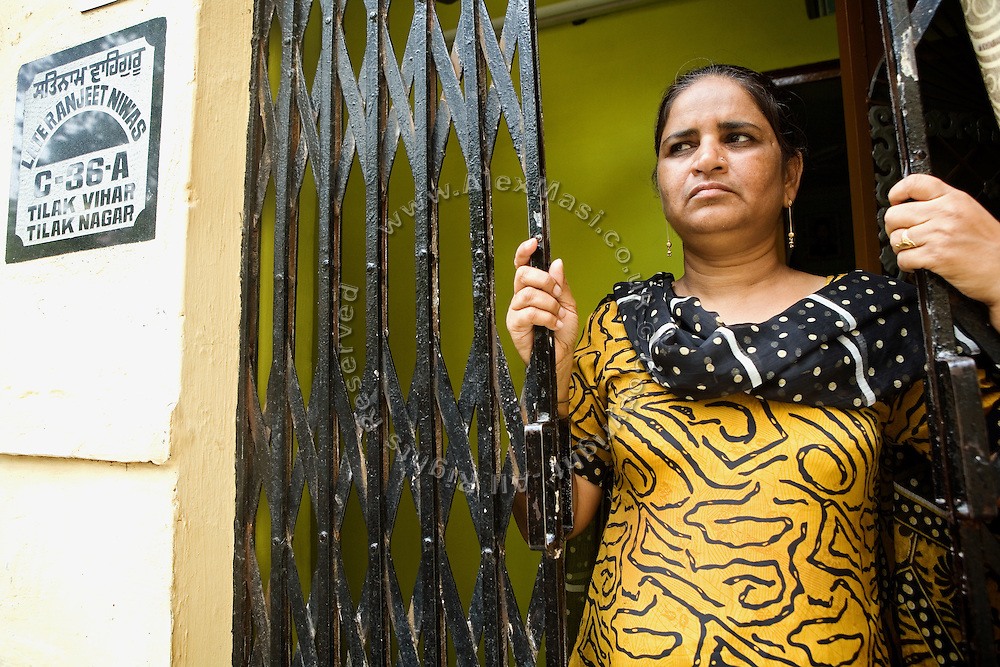 Harbans Kaur, 43, in front of her home in Tilak Vihar, New Delhi, India. She has lost her husband and other members of her family during the anti-Sikh riots erupted in New Delhi in 1984 in the light of Indira Gandhi's assassination by her Sikh bodyguards.