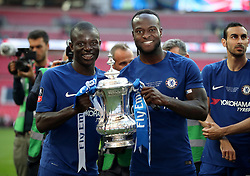 Chelsea's N'Golo Kante (left) and Victor Moses celebrate with the FA Cup trophy