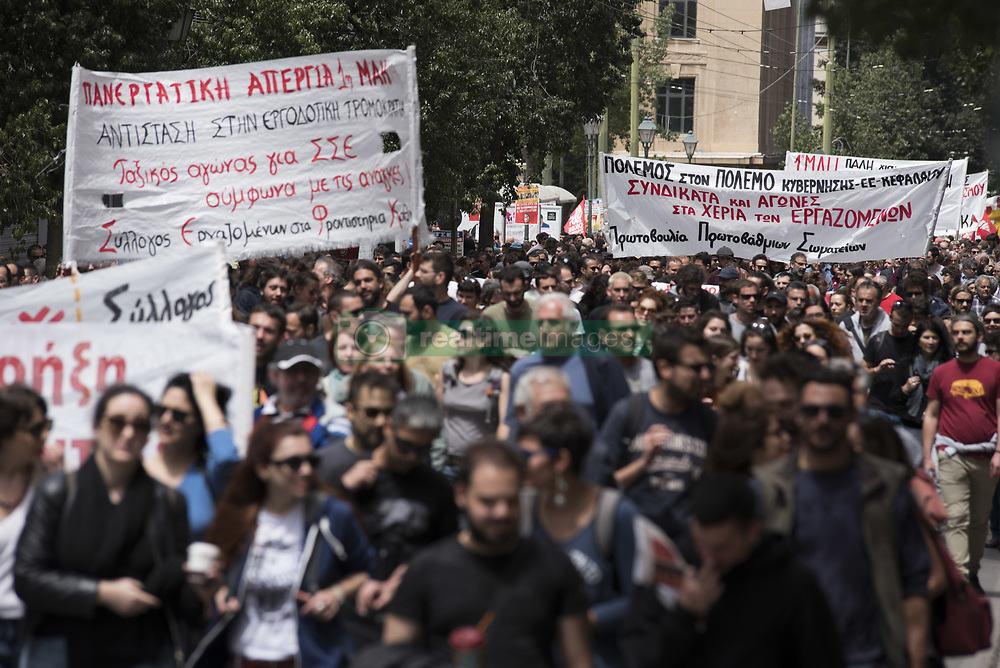 May 1, 2019 - Athens, Greece - Protesters march towards the Greek Parliament shouting slogans against austerity. Thousands, members of left-wing parties, workers' unions and anarchist groups took part in the annual May 1st demonstrations to mark the International Workers' Day. (Credit Image: © Nikolas Georgiou/ZUMA Wire)