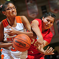 112812  Adron Gardner<br /> <br /> Gallup Bengal NI'asia McIntosh (34) and Shiprock Chieftain Ashley John (33) tie up for a pass in Gallup Saturday.