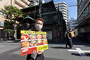 Restaurants touts looking for customers in Tsukiji outer market, Tokyo, Japan, Wednesday September 30th 2020