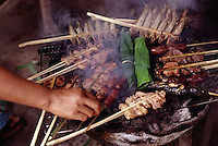 ca. August 1998, Vientiane, Laos --- Various brochettes of meats, sausages and fish in Vientiane, Laos. --- Image by © Owen Franken/CORBIS
