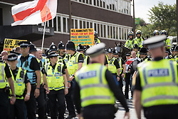 © Licensed to London News Pictures . 02/09/2017 . Keighley , UK . Police from seven forces are deployed to manage the demonstration . Far-right street protest movement , the English Defence League ( EDL ) , hold a demonstration in the West Yorkshire town of Keighley , opposed by anti-fascists , including Unite Against Fascism ( UAF ) . The EDL say they are demonstrating against the sexual grooming and abuse of English girls by Muslim men and against terrorism across the UK . Photo credit : Joel Goodman/LNP
