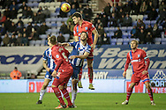 John Egan (Gillingham) clears a corner during the Sky Bet League 1 match between Wigan Athletic and Gillingham at the DW Stadium, Wigan, England on 7 January 2016. Photo by Mark P Doherty.