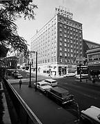 "Ackroyd 12642-07. ""Heathman Hotel. Exteriors. July 12, 1964"" (35mm B&W. SW Broadway & Taylor)"