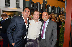 Left to right, GABRIELE ESPOSITO General Manager of Daphne's, MIKE BROWN head chef at Daphne's and JESUS ADORNO at the 50th anniversary party for Daphne's restaurant, 112 Draycott Avenue, London held on 24th June 2014.