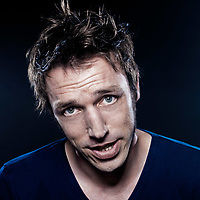 studio portrait on black background of a funny expressive caucasian man friendly cheerful