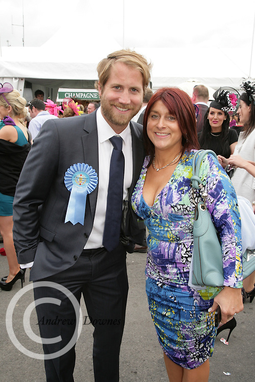 Majella Masterson of the Woodfield House Hotel Co Limerick with Budweiser Ice Cold Weather man Scott Campbell at the Galway Races on Thursday. Photo:- Andrews Downes