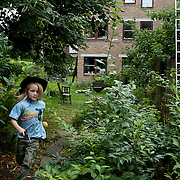 Linköping, Sweden, August 19, 2012.<br /> A boy plays in the garden of Stolplyckan co-housing, the second biggest collective in Sweden with 184 apartments.