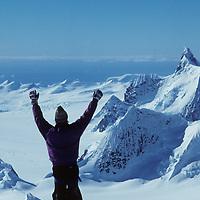 ANTARCTICA, Ski mountaineer (MR) atop Mt.Berry, Danco Coast, Antarctic Peninsula
