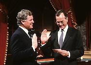 Vice President Hubert Walker Bush swears in Senator Ted Kennedy in re enactment of the Senate chamber swearing in ceremony in January 1983...Photograph by Dennis Brack bb32