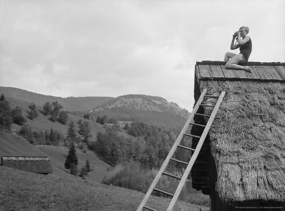 Gertraud Braun in the Bathing Suit with Camera Sitting on the Roof of the Hut, Austria, 1934