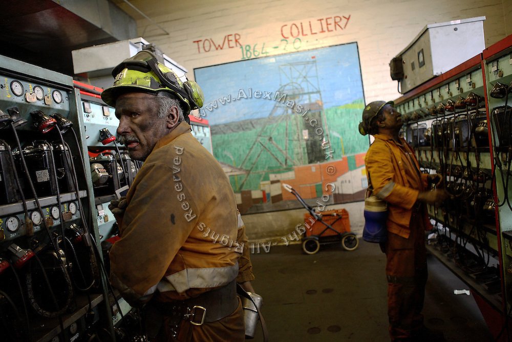 Miners are dropping their safety equipment in the lamp room of the last deep mine in Wales, Tower Colliery are about to leave after their shift underground on Wednesday, June 20, 2007, in Hirwaun, Vale of Neath, South Wales. The time is ripe again for an unexpected revival of the coal industry in the Vale of Neath due to the increasing prize and diminishing reserves of oil and gas, the uncertainties of renewable energy sources, and the technological advancement in producing energy from coal while limiting emissions of pollutants, has created the basis for valuable investment opportunities and a possible alternative to the latest energy crisis. Unity Mine, in particular, has started a pioneering effort to revive the coal industry in the area, reopening after more than 8 years with the intent of exploiting the large resources still buried underground. Coal could be then answer to both, access to cheaper and paradoxically greener energy and a better and safer choice than nuclear energy as a major supply for the decades to come. It is estimated that coal reserves in Wales amount to over 250 million tonnes, or the equivalent of at least 50 years of energy supply, while the worldwide total coal could last for over 200 years as a viable resource compared to only a few decades of oil and natural gas.