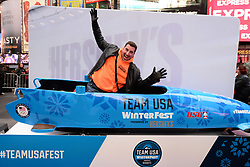 Alexander Mazzei climbs into an olympic bobsled during the Team USA Winter Fest  - 100 day countdown to the 2018 Winter Olympics, in Times Square, New York, on November 1, 2017. (Photo by Anthony Behar/Sipa USA)