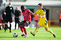 Lincoln City's Timothy Eyoma vies for possession with Oxford United's Joel Cooper<br /> <br /> Photographer Andrew Vaughan/CameraSport<br /> <br /> The EFL Sky Bet League One - Saturday 12th September  2020 - Lincoln City v Oxford United - LNER Stadium - Lincoln<br /> <br /> World Copyright © 2020 CameraSport. All rights reserved. 43 Linden Ave. Countesthorpe. Leicester. England. LE8 5PG - Tel: +44 (0) 116 277 4147 - admin@camerasport.com - www.camerasport.com - Lincoln City v Oxford United