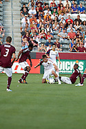 August 4, 2012: Real Salt Lake forward Justin Braun (13) tries to keep the ball away from the Colorado Rapids defense in the first half at Dick's Sporting Goods Park in Denver, Colorado