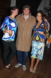 Left to right, Actress MARGO STILLEY, EDWARD TAYLOR and LULU STOFFEL at a party to celebrate the 4th anniversary of Quintessentially held at 11 Grosvenor Place, London  SW1 on 14th December 2004.<br /><br />NON EXCLUSIVE - WORLD RIGHTS