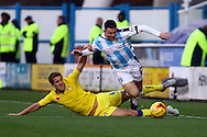 Scott Wootton of Leeds united tackles Harry Bunn of Huddersfield Town. Skybet football league Championship match, Huddersfield Town v Leeds United at the John Smith's Stadium in Huddersfield, Yorks on Saturday 7th November 2015.<br /> pic by Chris Stading, Andrew Orchard sports photography.