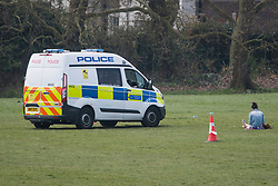 © Licensed to London News Pictures. 08/04/2020. London, UK. Police in a patrol vehicle ask a member of the public to move from Primrose Hill in North London, during a pandemic outbreak of the Coronavirus COVID-19 disease. The public have been told they can only leave their homes when absolutely essential, in an attempt to fight the spread of coronavirus COVID-19 disease. Photo credit: Ben Cawthra/LNP