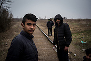 A 15 years old migrants is seen walking with other migrants from Pakistan on a rail road not far from Subotica, headed to the Hungarian border, they will wait the night and try to cross, probably with the help of smugglers. Subotica, Serbia. March 18th, 2017. Federico Scoppa