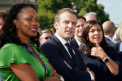 French President Emmanuel Macron (C) stands between city mayor Anne Hidalgo (R) and Sports Minister Laura Flessel (L) in Paris, France, June 24, 2017. The French capital is transformed into a giant Olympic park to celebrate International Olympic Days with a variety of sporting events for the public across the city during two days as the city bids to host the 2024 Olympic and Paralympic Games. Photo by Jean-Paul Pelissier/Pool/ABACAPRESS.COM