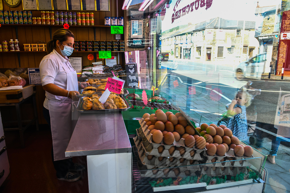 © Licensed to London News Pictures. 17/09/2020. Rhondda Valley, UK. A staff member pictured at a butchers in the former mining town of Treorchy in the Rhondda Valley which will go into local lockdown today after a spike in the coronavirus infection rate in the borough of Rhondda Cynon Taff in south Wales.. Photo credit: Robert Melen/LNP
