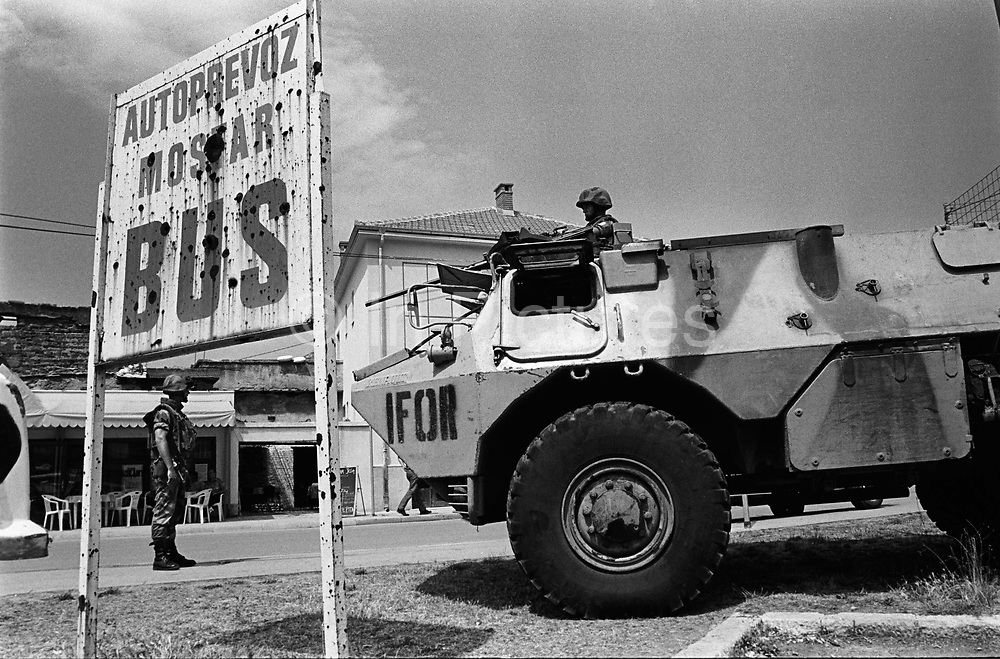 """IFOR peacekeepers on the front line between Muslim East Mostar and Croat West Mostar. It was destroyed by systemic bombardment from Croat guns during the Croat Muslim War, when the Croats endeavored to """" cleanse"""" the town of non Croats. Mostar, Bosnia and Herzegovina."""