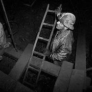 Harold ?Tubby? Burns holding a ladder at the exit of a shrinkage stope, 700 foot level, Cheminis Mine, Larder Lake, Ontario. From the book Cage Call: Life and Death in the Hard Rock Mining Belt. An in-depth project spanning over 12-years examining communities in one of the richest mining regions in the world located in Northwestern Ontario and Northeastern Quebec in Canada.