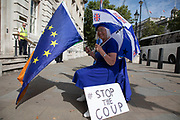 Anti Brexit protesters waving European Union flags and one with a 'stop the coup' placard outside the Cabinet Office in Westminster as it is announced that Boris Johnson has had his request to suspend Parliament approved by the Queen on 28th August 2019 in London, England, United Kingdom. The announcement of a suspension of Parliament for approximately five weeks ahead of Brexit has enraged Remain supporters who suggest this is a sinister plan to stop the debate concerning a potential No Deal. (photo by Mike Kemp/In Pictures via Getty Images)