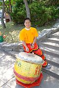 Festival drummer beating ceremonial drum. Dragon Festival Lake Phalen Park St Paul Minnesota USA