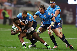 Inny Radebe of the Sharks is tackled by Travis Ishmael of the Bulls during the Currie Cup match between the The Sharks and The Blue Bulls held at King's Park, Durban, South Africa on the 27th August 2016<br /> <br /> Photo by:   Anesh Debiky / Real Time Images