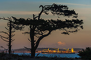 Cargo ship with Whidbey Island and Mount Baker in the distance, afternoon light, October, Admiralty Inlet, Salish Sea, view from Fort Worden State Park, Jefferson County, Port Townsend, Washington, USA