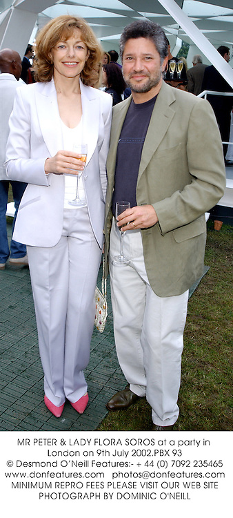 MR PETER & LADY FLORA SOROS at a party in London on 9th July 2002.			PBX 93