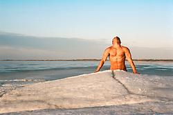 nude man on an iceberg in Montauk, NY