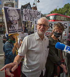 © Licensed to London News Pictures.  11/08/2021. London, UK. Former labour party leader Jeremy Corbyn joins supporters of Wikileaks founder Julian Assange who protest outside the Royal Courts of Justice in central London. The High Court will hear the first stage of a bid by the US government to appeal against a judge's decision not to extradite Julian Assange to face trial on espionage charges in America.  Photo credit: Marcin Nowak/LNP