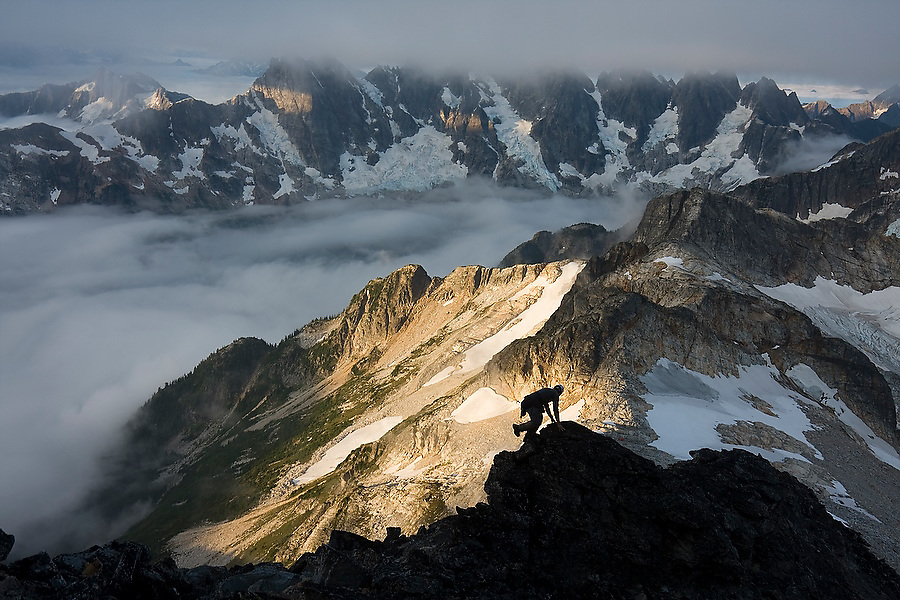 Jim Prager scrambles up Luna Peak at sunrise in the Northern Picket Range, North Cascades National Park, Washington. The view from the summit of Luna Peak is considered by those who have ventured there the most spectacular scenery of the Cascade Range.