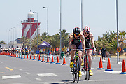 Lucy Hall beats Jessica Learmonth (both from Great Britain) to the finish line in a closely fought womens race during the Discovery Triathlon World Cup Cape Town 2017. Image by Greg Beadle