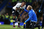 Danny Rose  of Tottenham Hotspur reacts as he receives treatment. Barclays Premier league match, Chelsea v Tottenham Hotspur at Stamford Bridge in London on Monday 2nd May 2016.<br /> pic by Andrew Orchard, Andrew Orchard sports photography.